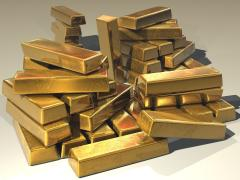 Prețul aurului scade. Leul rămâne stabil față de euro și se apreciază în raport cu dolarul american