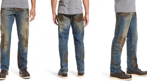 Nouă tendință în modă, blugii gata murdari. Cât costă o astfel de pereche