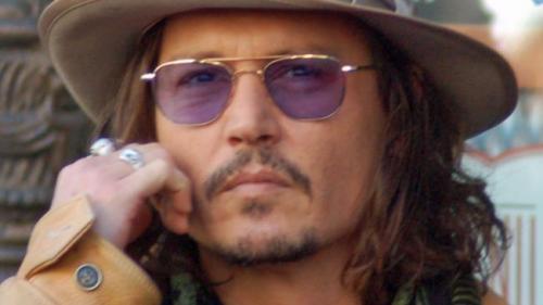 Acuzat de violenţă conjugală, Johnny Depp este apărat de romanciera J. K. Rowling