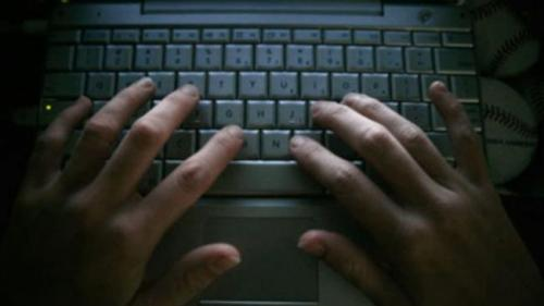 Hackeri români din SUA, condamnați la ani grei de închisoare în Cleveland