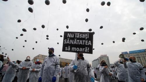 Manifest cu baloane negre